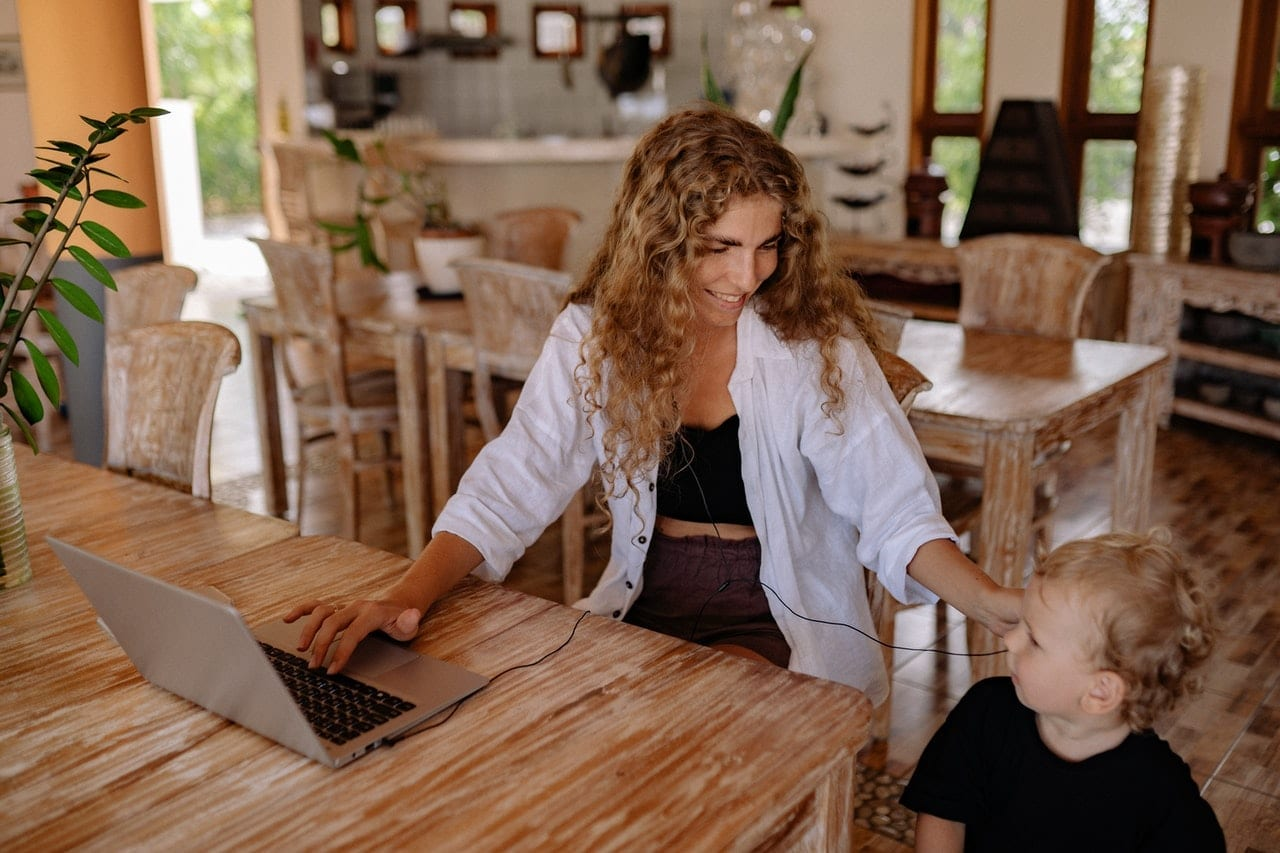 woman-working-from-home-with-son